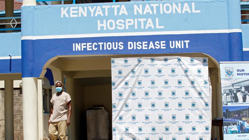 A worker walks outside the coronavirus isolation facility at the Mbagathi Hospital in Nairobi on Sunday [Njeri Mwangi/Reuters]