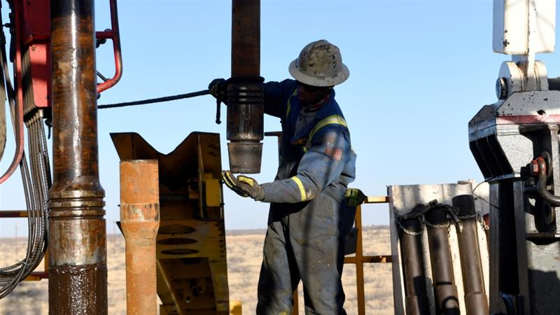 An oil worker near Midland Texas in the United States where several energy companies on Monday said they are cutting drilling activity and budgets becoming the latest North American shale producers to be hit by lower oil prices which fell below $30 [F