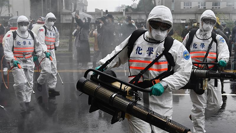 Soldiers work to prevent the spread of COVID-19 in Taipei's Xindian district [File: Sam Yeh/AFP]