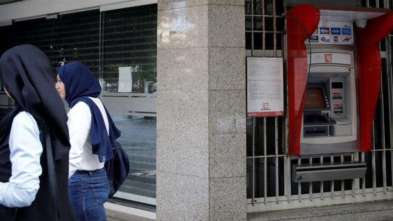 Bank branches in Lebanon will close from March 17-29 for the safety of employees during the coronavirus outbreak, the banking association said on Monday [File: Andres Martinez Casares/Reuters]