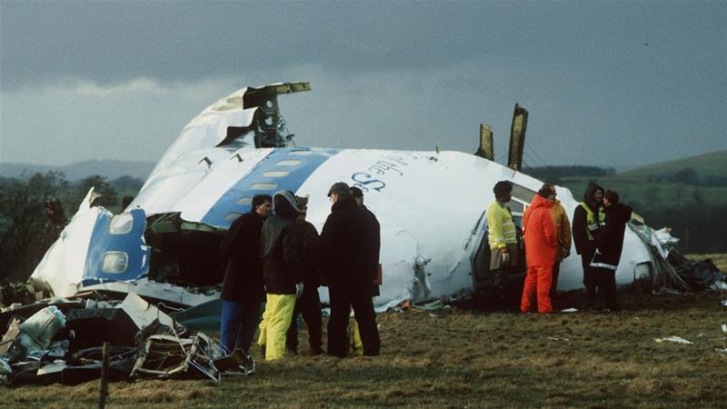 Rescue workers and investigators search the area around the cockpit of Pan Am flight 103 after a mid-air bombing killed all 259 on board and 11 on the ground. Picture taken December 23, 1988 [Reuters]