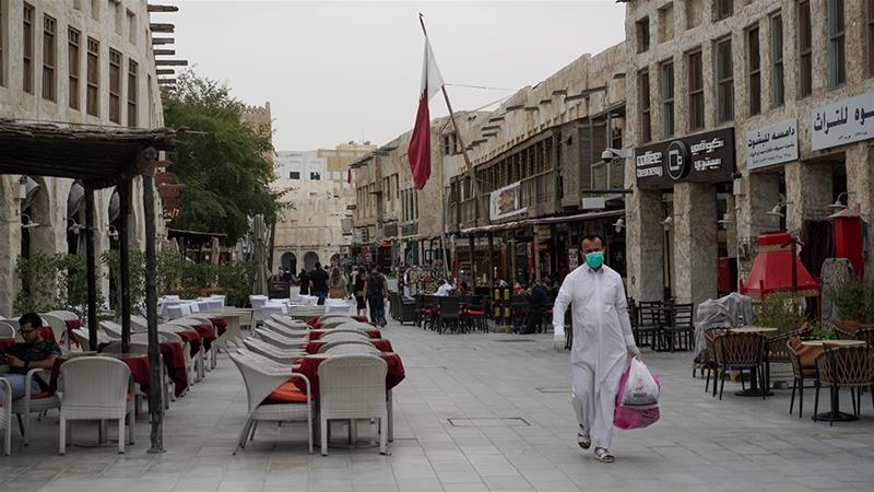 People wearing protective masks in Souq Waqif as the number of coronavirus cases increase in Doha, Qatar [Sorin Furcoi/Al Jazeera]