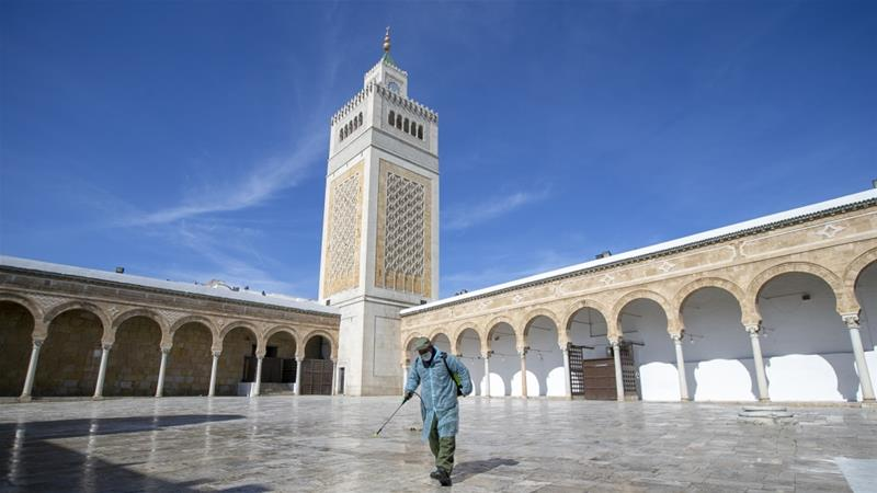 Officials carry out disinfection works as a precaution against COVID-19 at Al-Zaytuna Mosque in Tunis [Yassine Gaid/Anadolu]