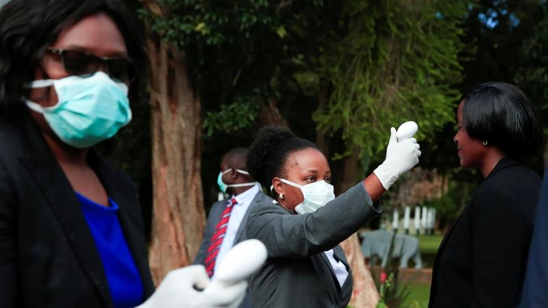 Health workers screen visitors to prevent the spread of coronavirus disease (COVID-19) at the State House in Harare, Zimbabwe, March 19, 2020. [File: Philimon Bulawayo/Reuters]