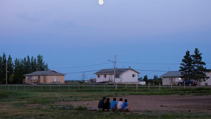 Children from the Cote First Nation sit at the campground, near the town of Kamsack, Saskatchewan, Canada [File: Zachary Prong/Reuters]