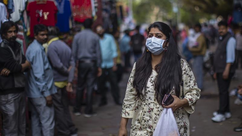 In India more than 200 people have been infected and four have died, with officials reporting multiple cases of people fleeing quarantine [Yawar Nazir/Getty Images]