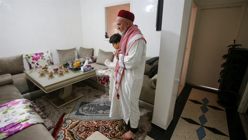 Ahmed, 57 and his son, 10, perform Friday prayers in their home as mosques are closed due to concerns about the spread of coronavirus in Casablanca, Morocco [Youssef Boudlal/Reuters]