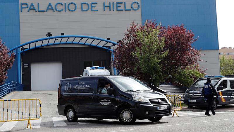 With Spain in its second week of lockdown, the Palacio de Hielo ice skating centre and shopping mall in northeast Madrid has been converted into a makeshift morgue [Cheme Moya/EPA-EFE]