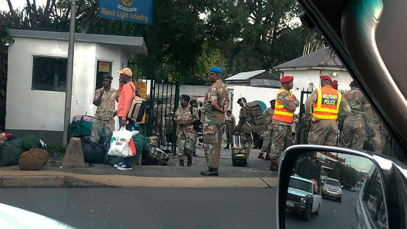 South African troops arrive at the Rand Light Infantry barracks in Johannesburg ahead of President Cyril Ramaphosa's announcement of a 21-day national lockdown [AP Photo/Jerome Delay]