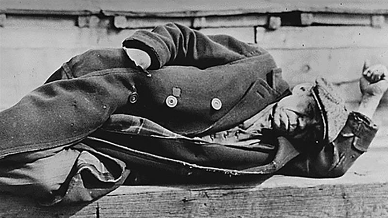 An unemployed man in an old coat is seen lying down on a pier in the New York City docks during the Great Depression, in 1935 [File: Lewis W Hine/Franklin D Roosevelt Presidential Library and Museum/National Archives and Records Administration/Handout/File Photo/Reuters]