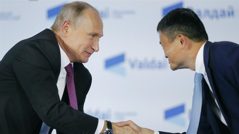 Russia's President Vladimir Putin shakes hands with Executive Chairman of Alibaba Group Jack Yun Ma during a session of the Valdai Discussion Club in Sochi, Russia in 2017 [File: Alexander Zemlianichenko/Pool/Reuters]
