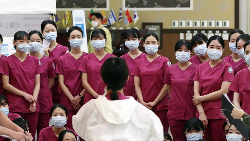 Graduates from the Korea Armed Forces Nursing Academy are briefed on the new coronavirus before being sent to Daegu, the centre of South Korea's COVID-19 outbreak [Yonhap via EPA]