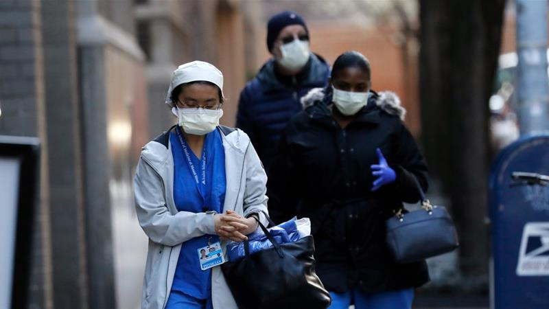 Hospital staff arrive at Mount Sinai West Hospital in New York, New York on March 26, 2020 [Peter Foley/EPA-EFE]