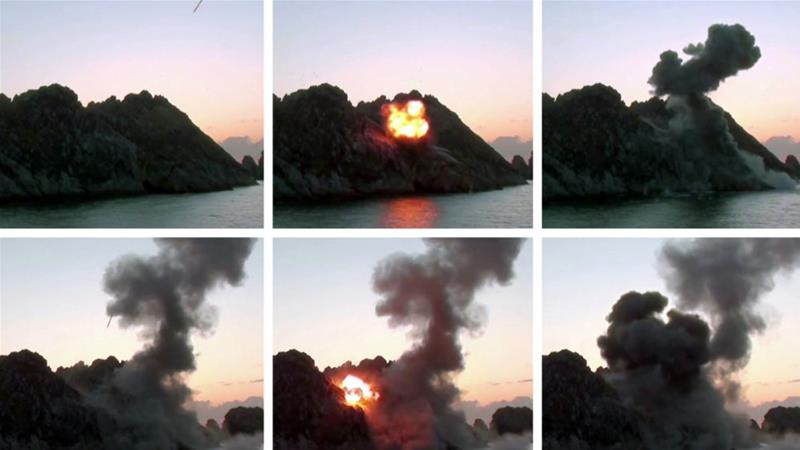 A combination of pictures showing what North Korean official media said was the testing of a super-large multiple rocket launcher on Sunday [KCNA via Reuters]