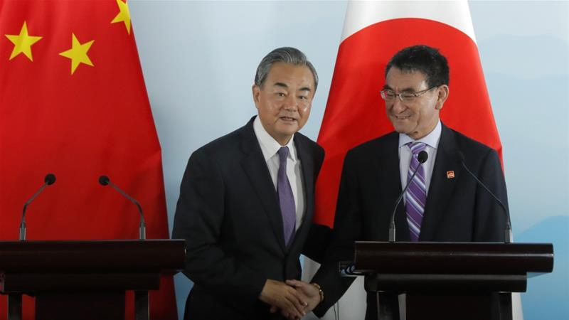 Taro Kono (right), defence minister of Japan, with Chinese Foreign Minister Wang Yi during a meeting in Beijing in 2019 [File: Wu Hong/AP]