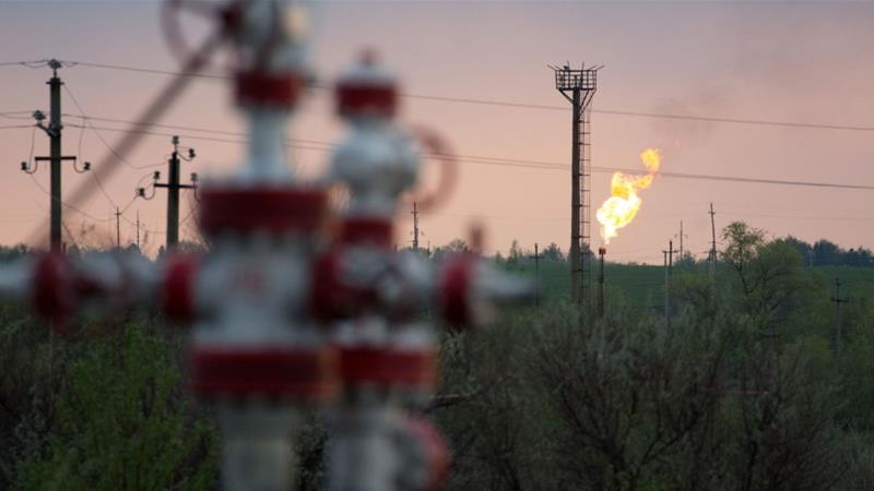 An oil flare stack and oil control valves in an oil field in Russia, which unlike many of its OPEC partners, could afford to sell oil at a lower price - $42 a barrel compared with the Saudi's $83 - to 'break even' or balance its national budget [File: Andrey Rudakov/Bloomberg]