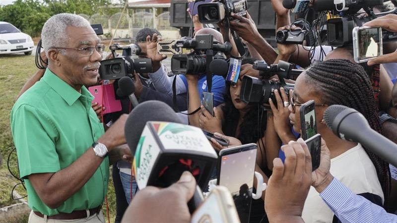 Guyana's incumbent President David Granger talks with journalists after Monday vote [National Unity and Alliance for Change Press Office/AFP]