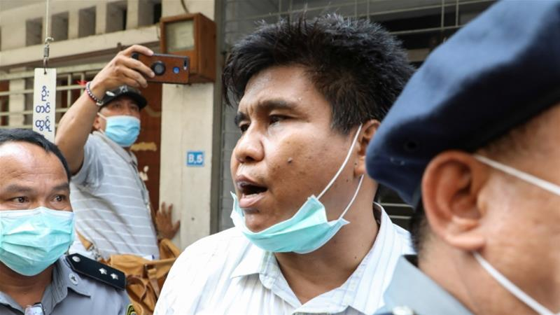 Nay Myo Lin, the editor-in-chief of Voice of Myanmar, was escorted into court by police in Mandalay on Tuesday [Stringer/Reuters]