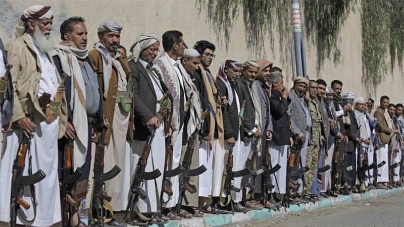 Tribesmen loyal to Houthi rebels hold their weapons during a gathering aimed at mobilising more fighters for the Houthi movement in Sanaa, Yemen on February 25, 2020 [File: AP/Hani Mohammed]