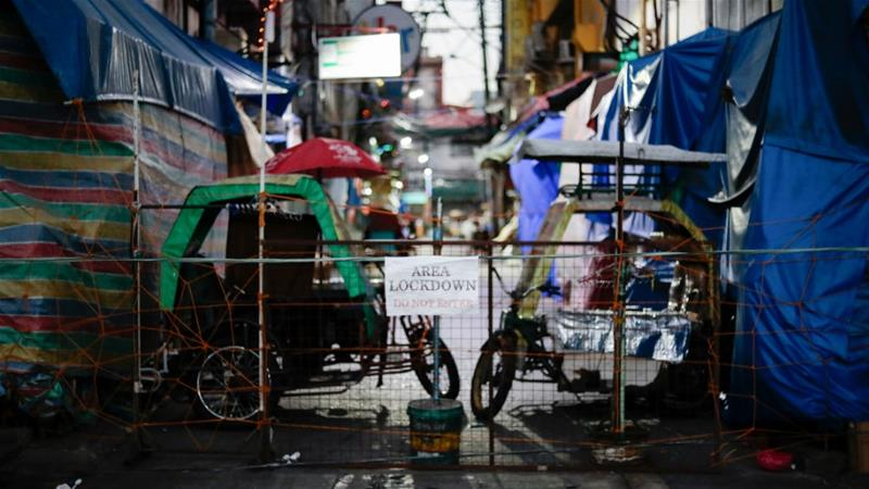 In the lockdown across the Philippines, the poor risk arrest as they try to find food [Eloisa Lopez/Reuters]