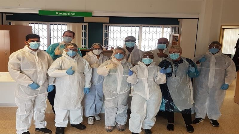 NHS workers at the Ettingshall Medical Centre receive PPE stitched together by volunteers at the Green Lane Masjid and Community Centre in Birmingham [Courtesy: Green Lane Masjid and Community Centre]