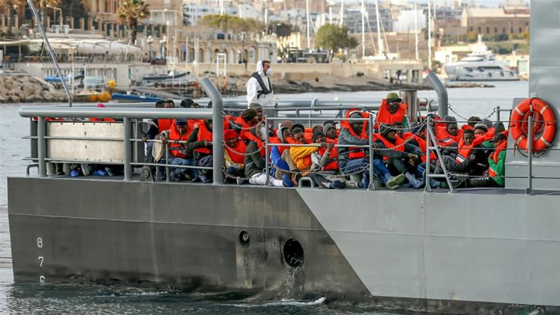 Migrants who were stranded on the German NGO Sea-Eye migrant rescue ship Alan Kurdi are seen before disembarking from an Armed Forces of Malta patrol boat at its base in Marsamxett Harbour, Valletta [Darrin Zammit Lupi/Reuters]
