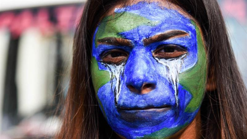 A young woman takes part in Fridays for Future, a worldwide youth climate strike, in Guwahati, Assam, India on November 8, 2019 [File: David Talukdar/NurPhoto via Getty Images]