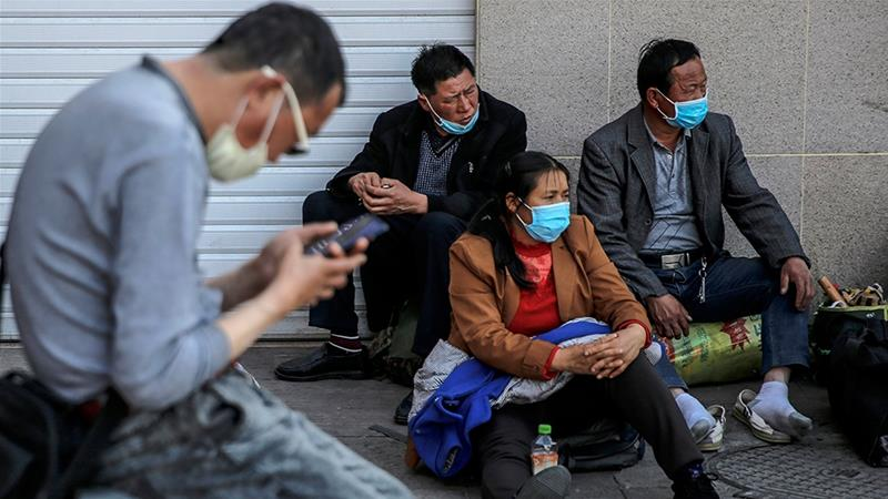 The shutdown of China's economy happened around the Lunar New Year in January stranding millions of workers in remote towns and villages, far from their factories and offices [File: Wu Hong/EPA]