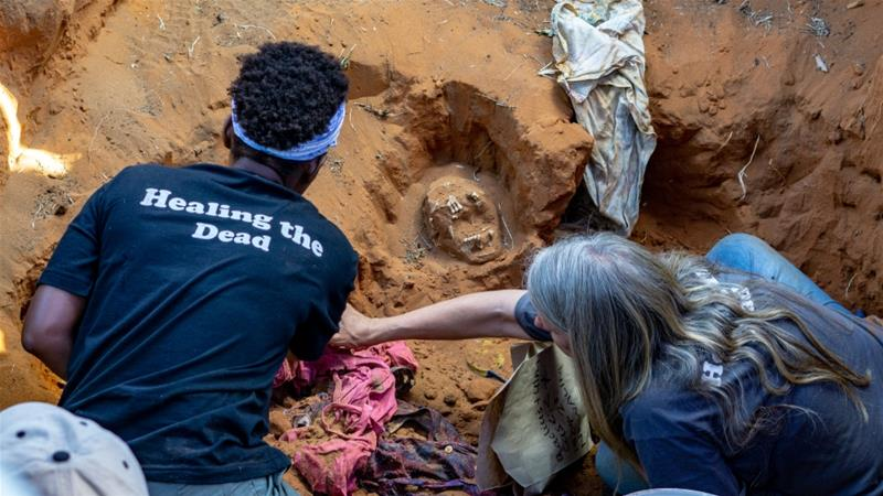 Members of Ukuthula Trust, a local NGO of pathologists and community workers, exhume the skeletal remains of Justin Tshuma and Thembi Ngwenya in Tsholotsho district [File: Tendai Marima/Al Jazeera[