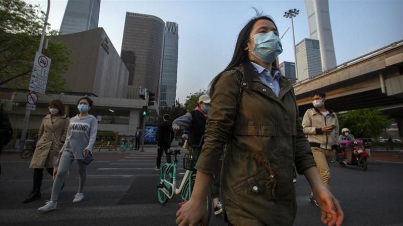 People are getting back to work in Beijing, but residents say life now is very different from what it was before the coronavirus appeared [Mark Schiefelbein/AP Photo]