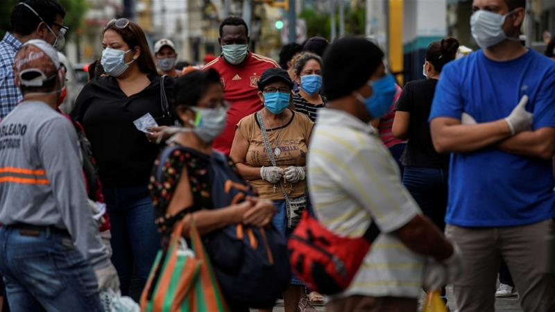 People queue outside a pharmacy amid the outbreak of the coronavirus disease (COVID-19), in Guayaquil, Ecuador [Santiago Arcos/Reuters]