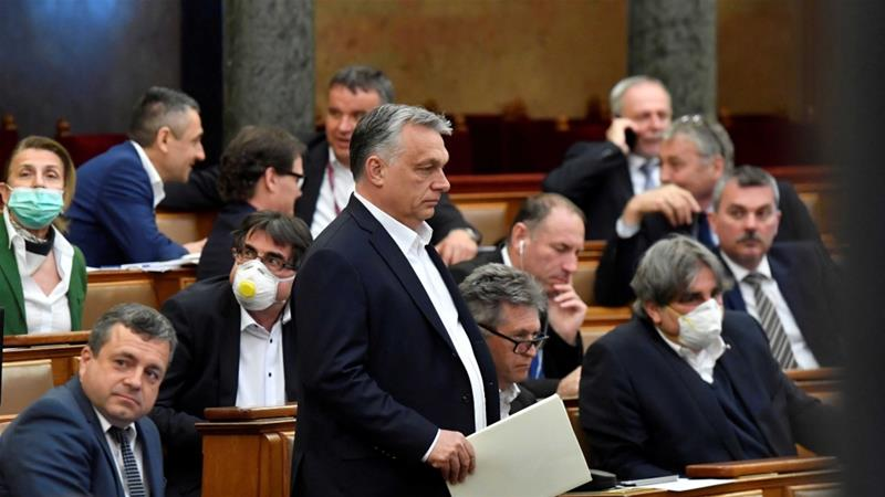 Hungarian Prime Minister Viktor Orban arrives in parliament ahead of a vote on a special law to combat the coronavirus crisis in Budapest, Hungary on March 30, 2020 [Reuters/Zoltan Mathe]