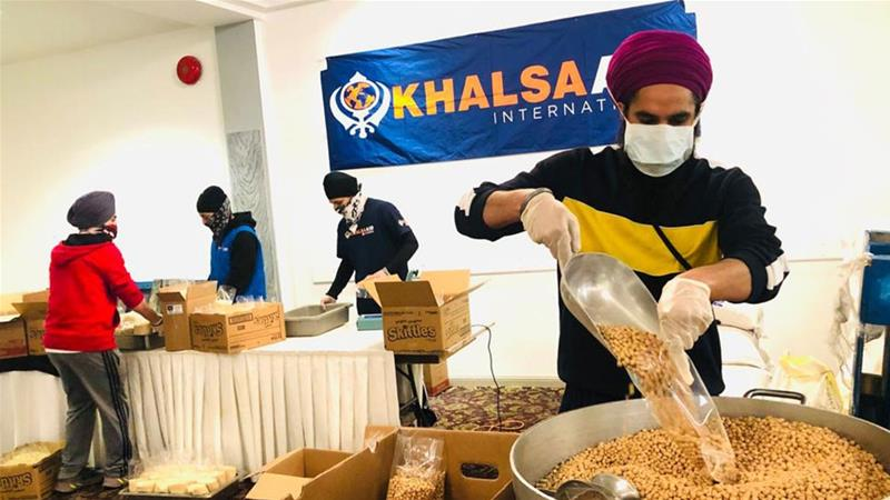 Khalsa Aid volunteers put together items to deliver to their communities [Courtesy of  Khalsa Aid]