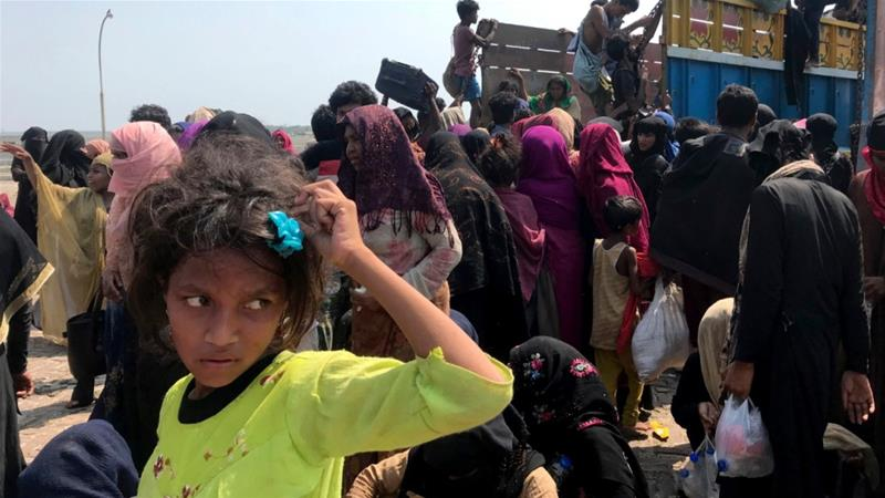 Rohingya refugees gather after being rescued in Teknaf near Cox's Bazar, Bangladesh after their boat had drifted at sea for weeks after failing to reach Malaysia [File: Suzauddin Rubel/AP]