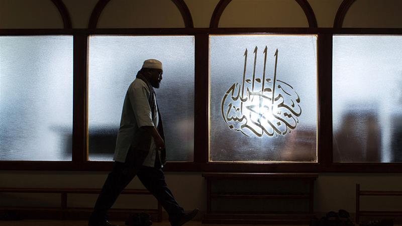 Imam Suleimaan Hamed, the leader of the Atlanta Masjid of Al Islam mosque, walks through the mosque, in Atlanta, Georgia [File: Branden Camp/AP Photo]