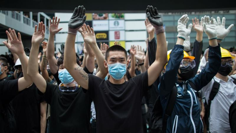 Mass protesters began in Hong Kong last June over a now-shelved extradition bill that would have allowed the transfer of suspects for trial in mainland China [Jerome Favre/EPA]