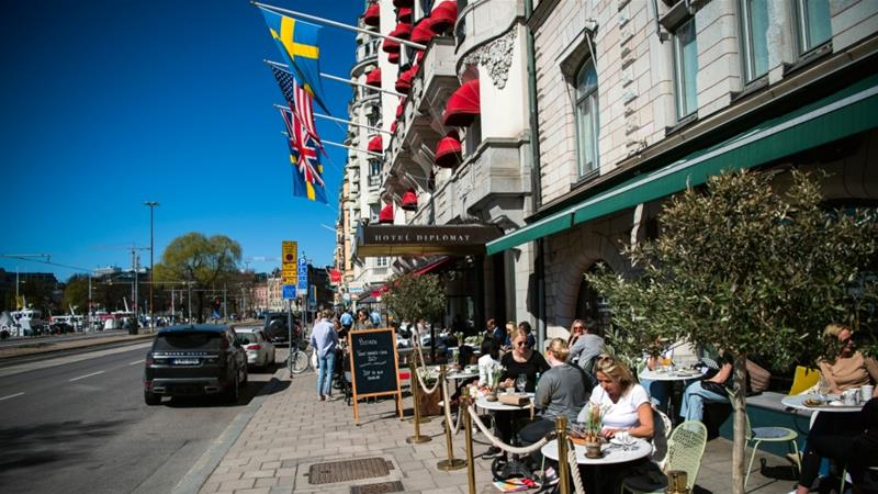 People have lunch at a restaurant in Stockholm amid the coronavirus pandemic [Jonathan Nackstrand/AFP]