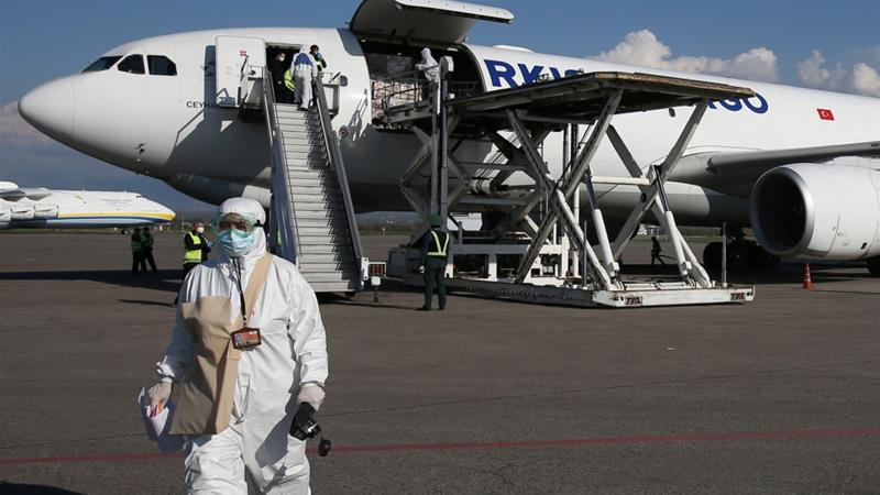 A worker wears protective gear as a shipment of Turkish medical supplies intended to combat the spread of the coronavirus disease (COVID-19) is unloaded from a cargo plane [File: Pavel Mikheyev/Reuters]