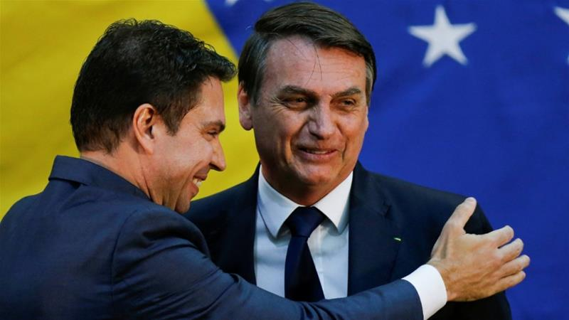 Brazil's President Jair Bolsonaro greeting Alexandre Ramagem during his inauguration ceremony as the new general director of the Brazilian Intelligence Agency (ABIN) in Brasilia, Brazil [File: Adriano Machado/Reuters]