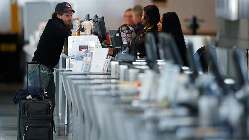 A lone passenger checks in at the ticketing counter for United Airlines during the coronavirus pandemic at Denver International Airport in Denver, Colorado, the United States [File: David Zalubowski/AP Photo]