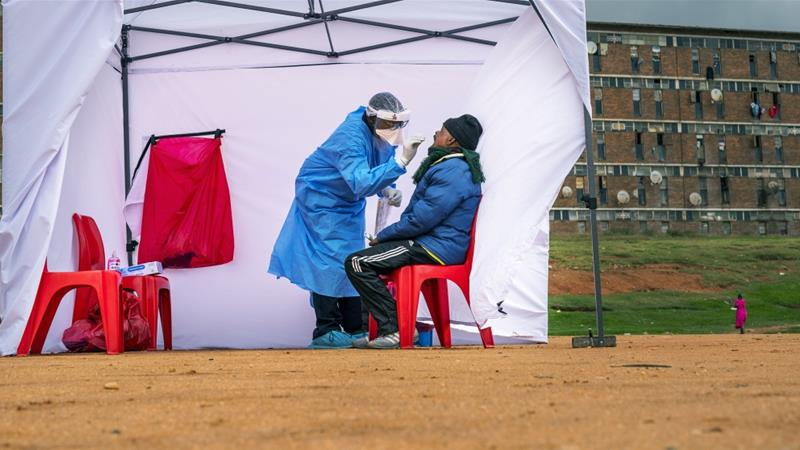 A resident from Alexandra township gets tested for COVID-19 in Johannesburg, South Africa [File: Jerome Delay/ The Associated Press]