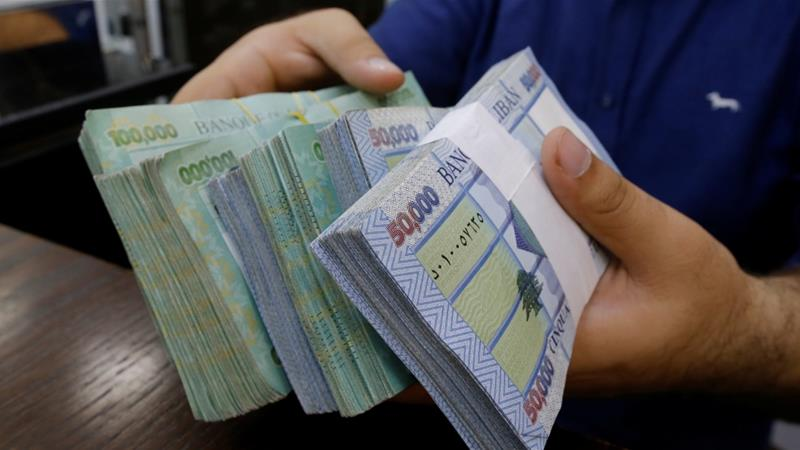 A decision by Lebanon's central bank could soon make it possible for people with accounts containing $3,000 or less to withdraw their money in Lebanese pounds at the market rate, which currently stands at about 2,800 Lebanese pounds to the United States dollar [File: Mohamed Azakir/ Reuters]
