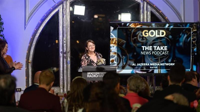 Al Jazeera Digital's head of audio, Graelyn Brashear, accepts medals at the 2019 New York Festivals Radio Awards. Ceremonies this year were cancelled due to the COVID-19 pandemic [File: Al Jazeera]