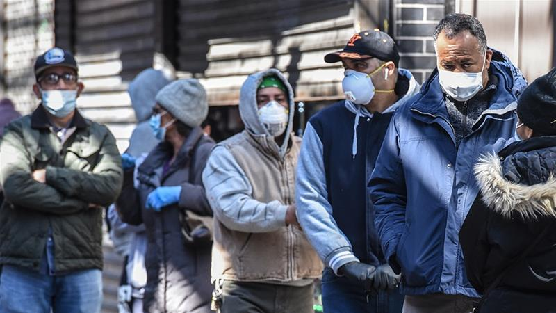 With the number of coronavirus cases surging in the US, the country is now advising people to wear face masks when out in public [Stephanie Keith/Getty Images/AFP]