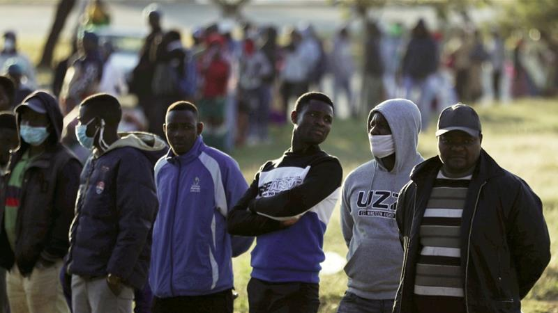 Informal traders stand in a queue as they wait to apply for a permit amid a nationwide COVID-19 lockdown, in Soweto, South Africa April 23, 2020 [Siphiwe Sibeko/Reuters]