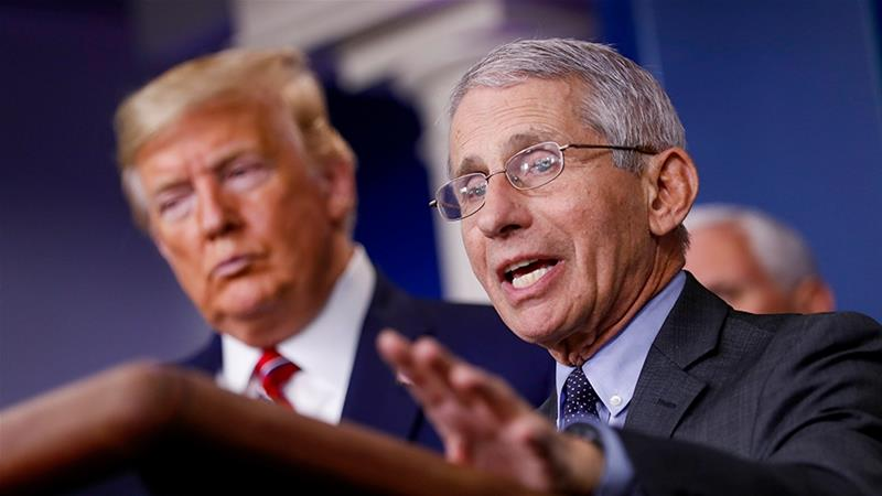 Anthony Fauci, right, speaks as US President Trump, left, listens during a Coronavirus Task Force news conference on March 20, 2020 [Al Drago/ EPA]