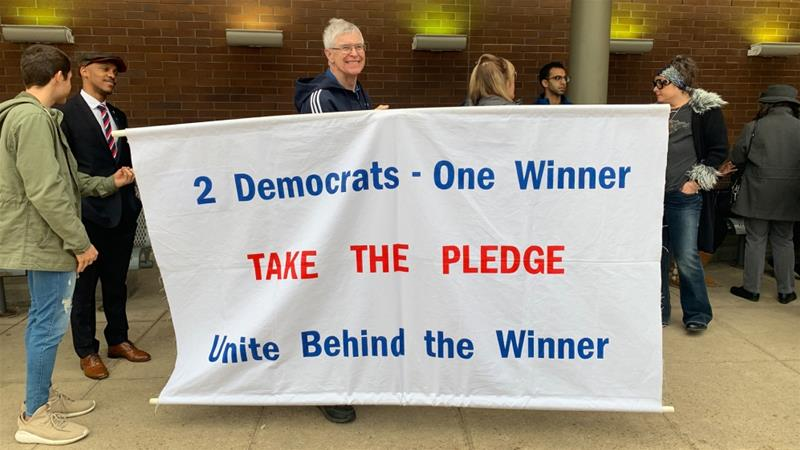 Supporters outside of a Joe Biden rally in Detroit, Michigan on March 9, 2020 [Jeremy Young/Al Jazeera]