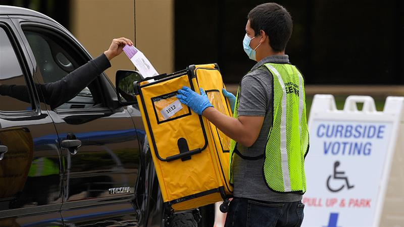 Voters drop off ballots in a special election for California's 25th Congressional District during the coronavirus outbreak in Simi Valley, California [Mark J Terrill/AP Photo]