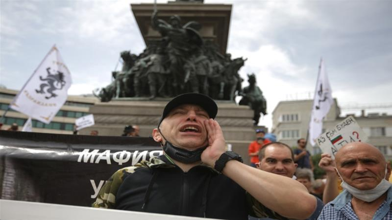 A supporter of Vazrazhdane (Revival) party shouts as he takes part in an anti-government protest in front of the parliament in Sofia, Bulgaria, May 14, 2020 [Stoyan Nenov/Reuters]