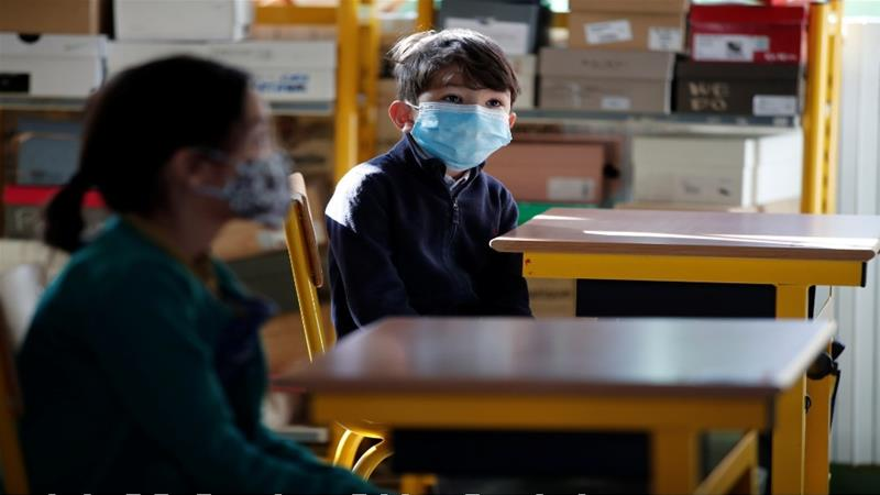 Pupils wearing protective face masks are seen in a classroom at a primary school during its reopening in Paris [Benoit Tessier/Reuters]